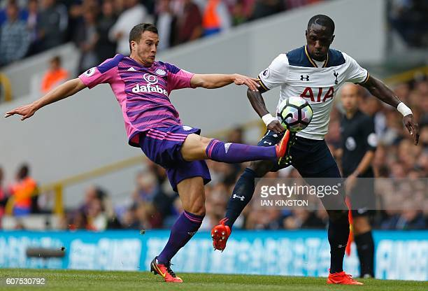 Sunderland's Spanish defender Javier Manquillo vies with Tottenham Hotspur's French midfielder Moussa Sissoko during the English Premier League...