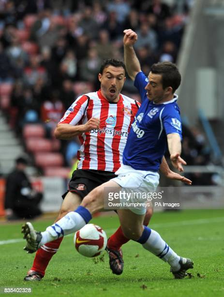 Sunderland's Steed Malbranque and Everton's Leighton Baines battle for the ball
