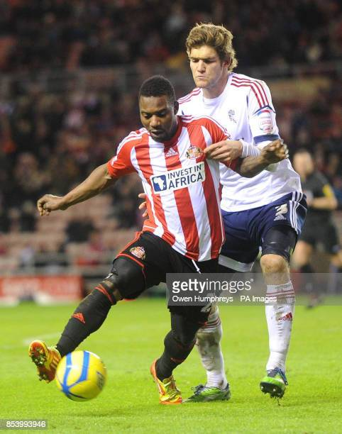 Sunderland's Stephane Sessegnon and Bolton's Marcos Alonso in action during the FA Cup Third Round Replay at the Stadium of Light Sunderland