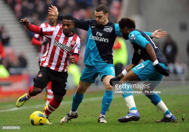 Sunderland's Stephane Sessegnon in action with Arsenals Thomas Vermaelen and Alex Song during the Barclays Premier League match at the Stadium of...