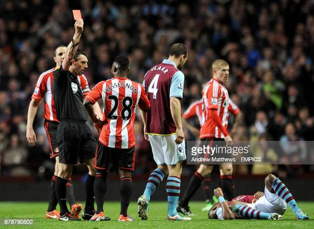 Sunderland's Stephane Sessegnon is shown a red card by refere Lee Probert for his challenge on Aston Villa's Yacouba Sylla
