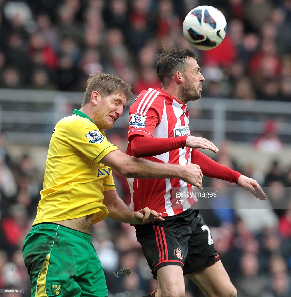 "Sunderland's Steven Fletcher (R) jumps to head the ball with Norwich's Michael Turner during the English Premier League football match between Sunderland and Norwich City at The Stadium of Light in Sunderland, north-east England, on March 17, 2013. The match ended 1-1. USE. No use with unauthorized audio, video, data, fixture lists, club/league logos or ""live"" services. Online in-match use limited to 45 images, no video emulation. No use in betting, games or single club/league/player publications."