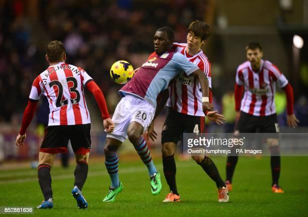 Sunderland's SungYeung Ki and Aston Villa's Christian Benteke battle for the ball