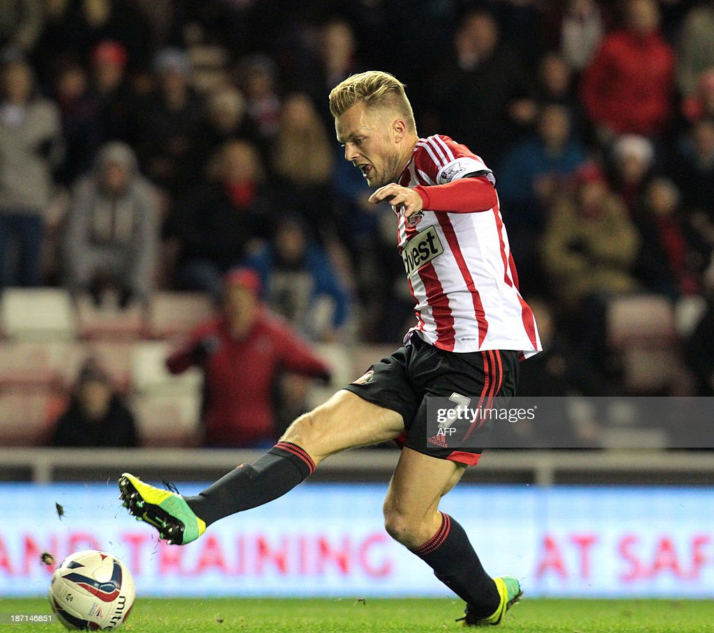 Sunderland's Swedish midfielder Sebastian Larsson scores his team's second goal during the English League Cup football match between Sunderland AFC and Southampton FC at the Stadium of Light in Sunderland, northern England, on November 6, 2013.