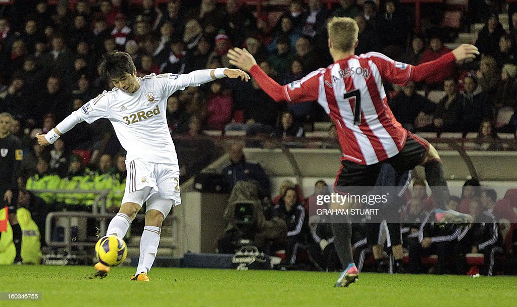 "Sunderland's Swedish midfielder Sebastian Larsson (R) vies with Swansea City's South Korean midfielder Ki Sung-Yeung (L) during the English Premier League football match between Sunderland and Swansea City at The Stadium of Light in Sunderland, north-east England on January 29, 2013. The game finished 0-0. USE. No use with unauthorized audio, video, data, fixture lists, club/league logos or ""live"" services. Online in-match use limited to 45 images, no video emulation. No use in betting, games or single club/league/player publications"