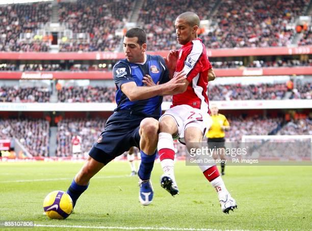 Sunderland's Tal BenHaim and Arsenal's Gael Clichy battle for the ball