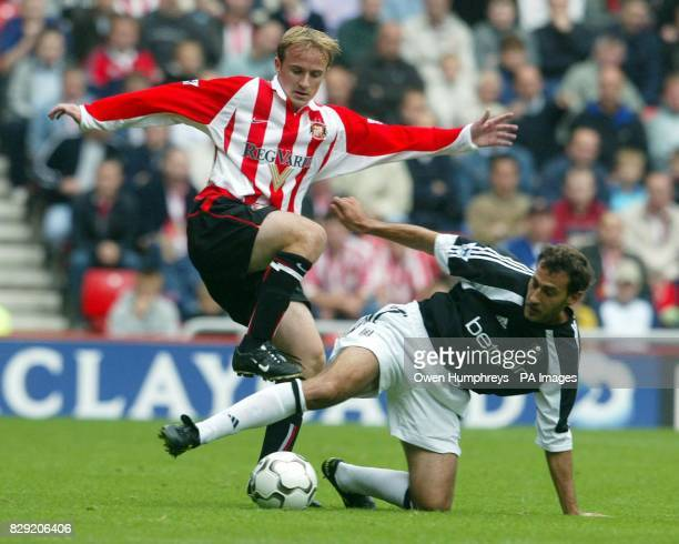 Sunderland's Thomas Butler tussles with Fulham's Sylvain Legwinski for the ball during their FA Barclaycard Premiership match at Sunderland's Stadium...
