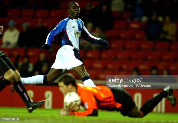 Sunderland's Thomas Sorensen makes a save from Blackburn's Andy Cole during the FA Cup Fourth Round replay match at The Stadium of Light THIS PICTURE...