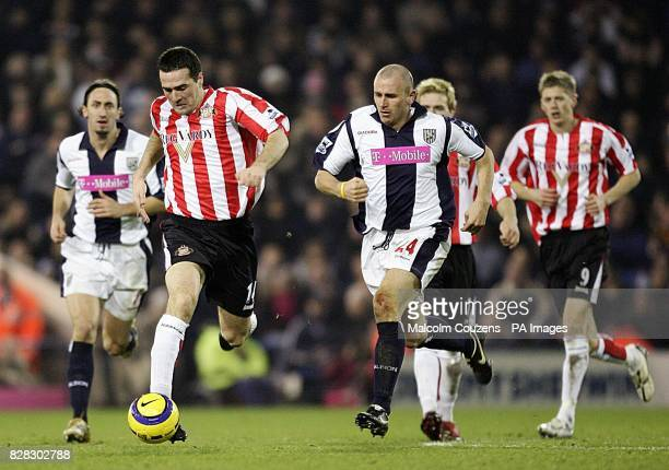 Sunderland's Tommy Miller breaks away from West Bromwich Albion's Ronnie Wallwork