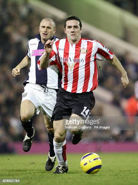 Sunderland's Tommy Miller is chased by West Bromwich Albion's Ronnie Wallwork