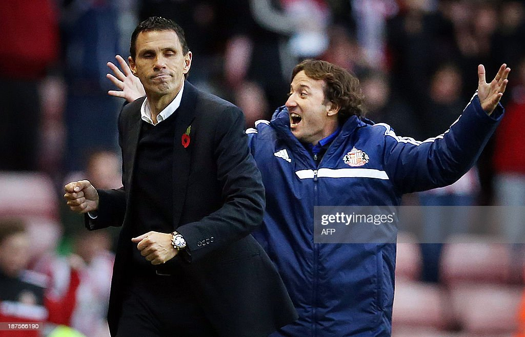 Sunderland's Uruguay manager Gus Poyet (L) celebrates at full time in the English Premier League football match between Sunderland and Manchester City at Stadium of Light in Sunderland, northeast England on November 10, 2013. Sunderland won 1-0. USE. No use with unauthorized audio, video, data, fixture lists, club/league logos or live services. Online in-match use limited to 45 images, no video emulation. No use in betting, games or single club/league/player publications.