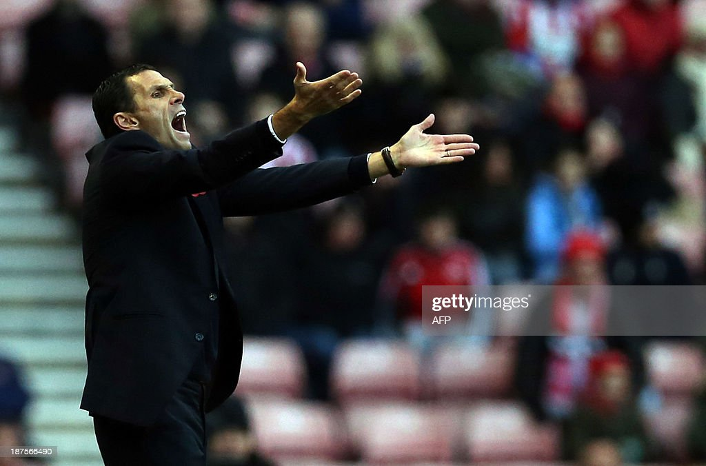 Sunderland's Uruguay manager Gus Poyet gestures from the touchline during the English Premier League football match between Sunderland and Manchester City at Stadium of Light in Sunderland, northeast England on November 10, 2013. Sunderland won 1-0. USE. No use with unauthorized audio, video, data, fixture lists, club/league logos or live services. Online in-match use limited to 45 images, no video emulation. No use in betting, games or single club/league/player publications.