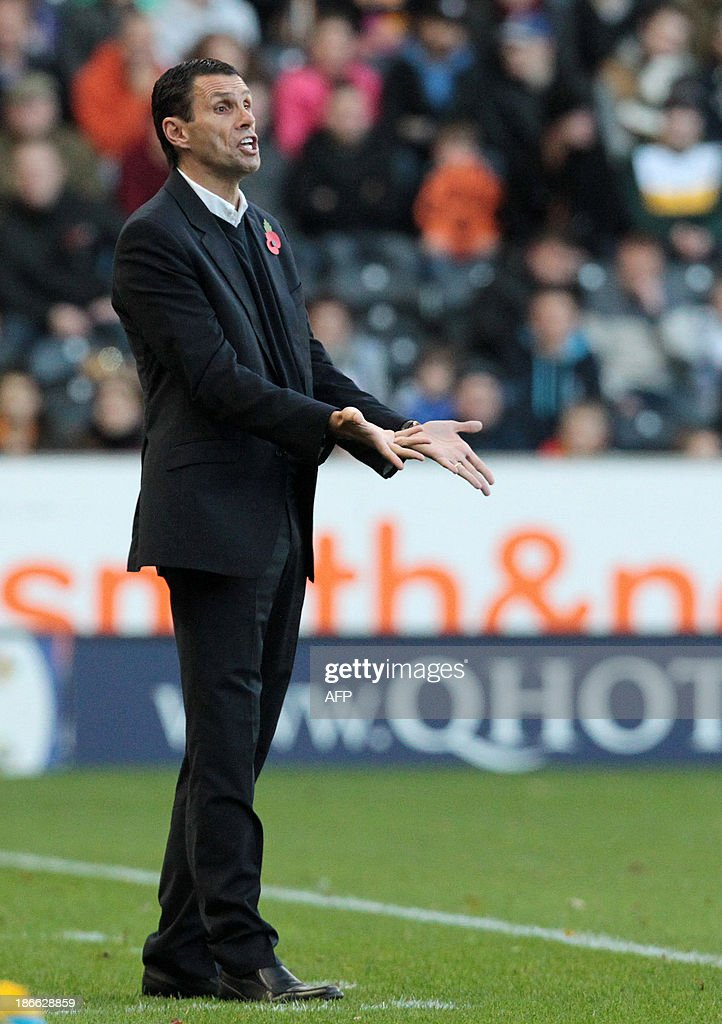 Sunderland's Uruguayan manager Gus Poyet reacts during the English Premier League football match between Hull City and Sunderland at The KC Stadium in Hull on November 2, 2013. USE. No use with unauthorized audio, video, data, fixture lists, club/league logos or live services. Online in-match use limited to 45 images, no video emulation. No use in betting, games or single club/league/player publications.