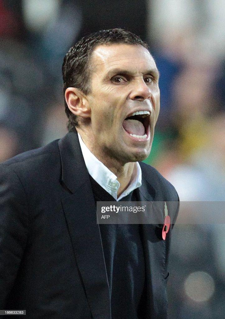 Sunderland's Uruguayan manager Gus Poyet reacts during the English Premier League football match between Hull City and Sunderland at The KC Stadium in Hull on November 2, 2013. Hull won the match 1-0. USE. No use with unauthorized audio, video, data, fixture lists, club/league logos or live services. Online in-match use limited to 45 images, no video emulation. No use in betting, games or single club/league/player publications.