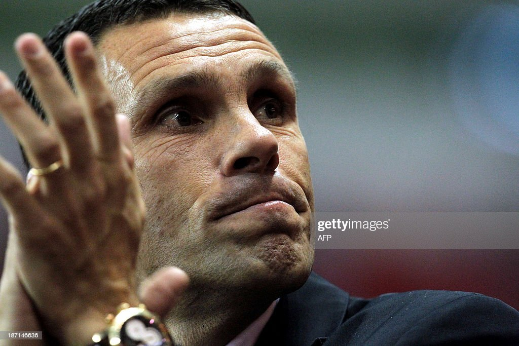 Sunderland's Uruguayan manager Gus Poyet takes his seat before the start of the English League Cup football match between Sunderland AFC and Southampton FC at the Stadium of Light in Sunderland, northern England, on November 6, 2013.