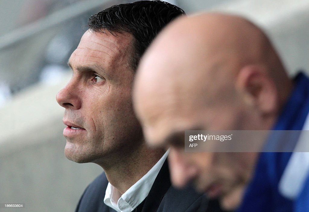 Sunderland's Uruguayan manager Gus Poyet (L) takes his seat for English Premier League football match between Hull City and Sunderland at The KC Stadium in Hull on November 2, 2013. Hull won the game 1-0. USE. No use with unauthorized audio, video, data, fixture lists, club/league logos or live services. Online in-match use limited to 45 images, no video emulation. No use in betting, games or single club/league/player publications.