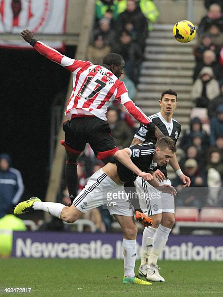 Sunderland's US striker Jozy Altidore tackles Southampton's English defender Calum Chambers during the English Premier League football match between...