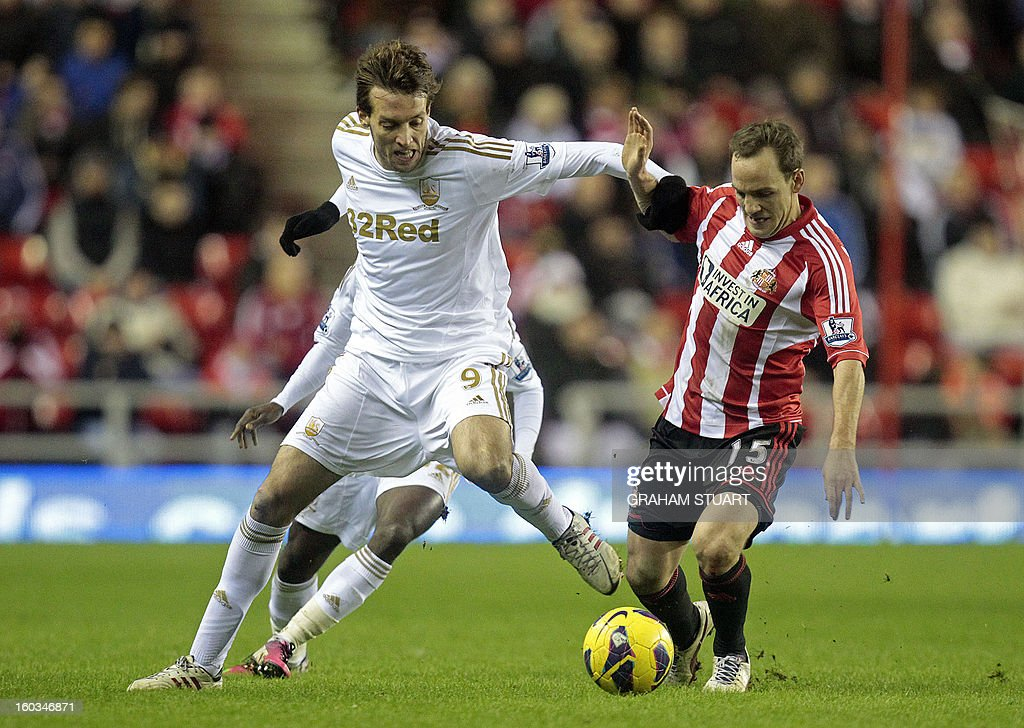 "Sunderland's Welsh midfielder David Vaughan (R) vies with Swansea City's Spanish striker Miguel Michu (L) during the English Premier League football match between Sunderland and Swansea City at The Stadium of Light in Sunderland, north-east England on January 29, 2013. The game finished 0-0. USE. No use with unauthorized audio, video, data, fixture lists, club/league logos or ""live"" services. Online in-match use limited to 45 images, no video emulation. No use in betting, games or single club/league/player publications"