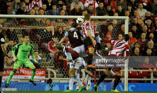 Sunderland's Wes Brown challenges West Ham's Kevin NolanGuy Demel and Winston Reid