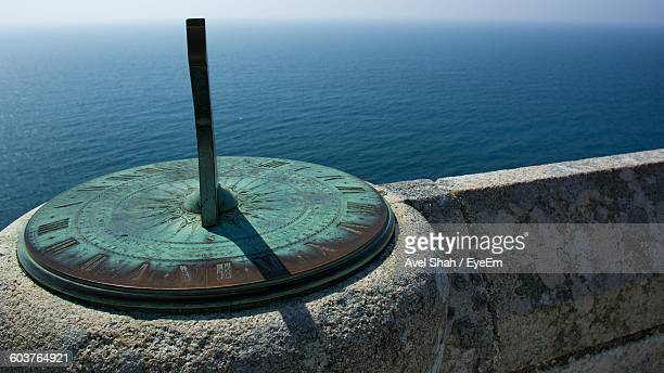Sundial By Retaining Wall At Seaside