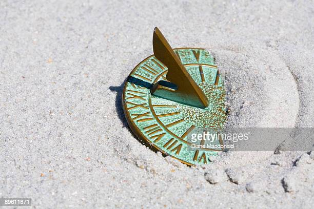 A sundial in the sand at noon