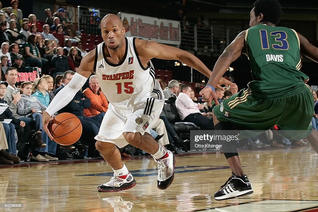 Sundiata Gaines of the Idaho Stampede moves the ball against Chris Davis of the Reno Bighorns during the DLeague game at Qwest Arena on November 28...