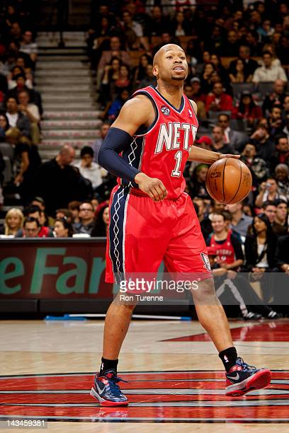 Sundiata Gaines of the New Jersey Nets directs his teammates against the Toronto Raptors on April 26 2012 at the Air Canada Centre in Toronto Ontario...
