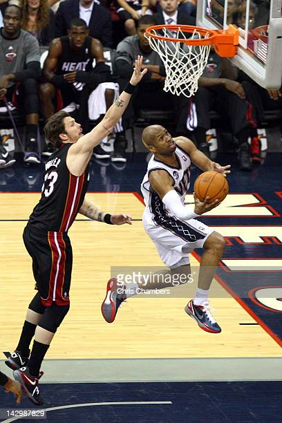 Sundiata Gaines of the New Jersey Nets drives for a shot attemp in the second half against Mike Miller of the Miami Heat at Prudential Center on...