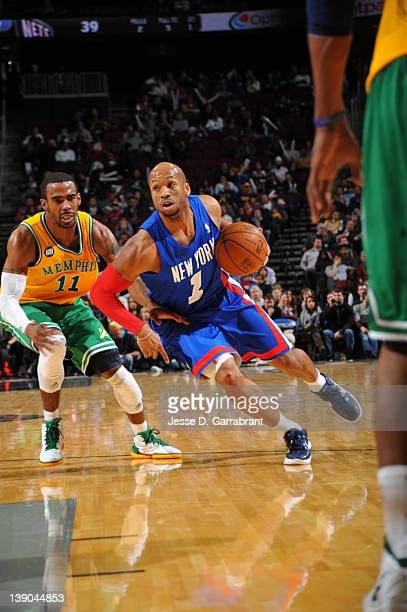 Sundiata Gaines of the New Jersey Nets drives to the basket against Mike Conley of the Memphis Grizzlies on February 15 2012 at the Prudential Center...