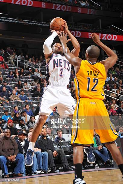 Sundiata Gaines of the New Jersey Nets shoots against AJ Price of the Indiana Pacers on March 28 2012 at the Prudential Center in Newark New Jersey...