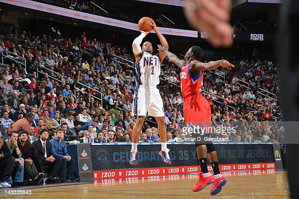 Sundiata Gaines of the New Jersey Nets shoots against the Philadelphia 76ers during the game on April 23 2012 at the Prudential Center in Newark New...
