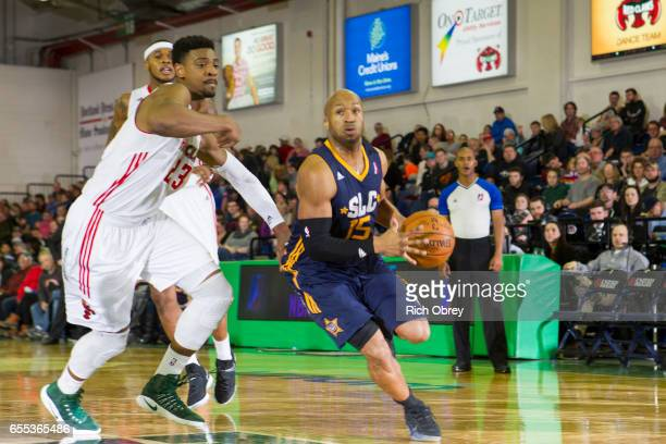 Sundiata Gaines of the Salt Lake City Stars drives around Jordan Mickey of the Maine Red Claws on Sunday March 19 2017 at the Portland Expo in...