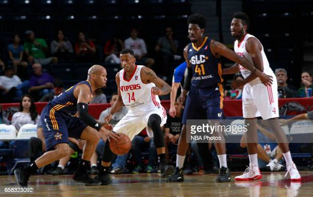 Sundiata Gaines of the Salt Lake City Stars looks for a pass as Troy Williams of the Rio Grande Valley Vipers defends at the State Farm Arena March...