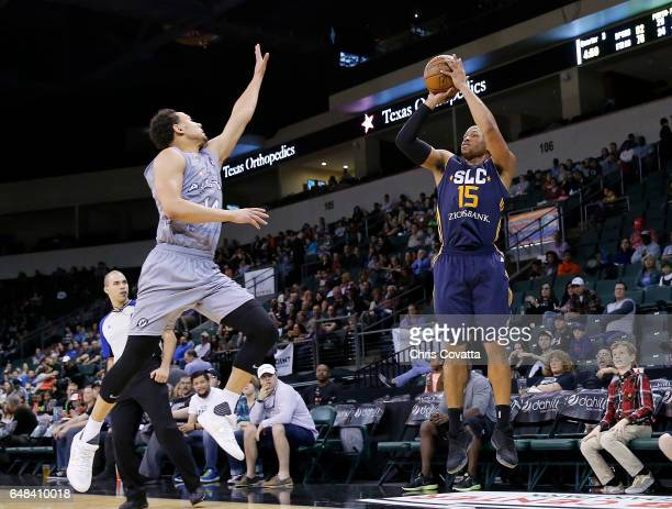 Sundiata Gaines of the Salt Lake City Stars shoots over Bryn Forbes of the Austin Spurs at the HEB Center At Cedar Park on March 5 2017 in Cedar Park...