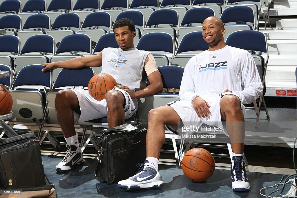 Sundiata Gaines of the Utah Jazz talks with Ronnie Price of the Utah Jazz prior to the game against the Memphis Grizzlies at EnergySolutions Arena on...