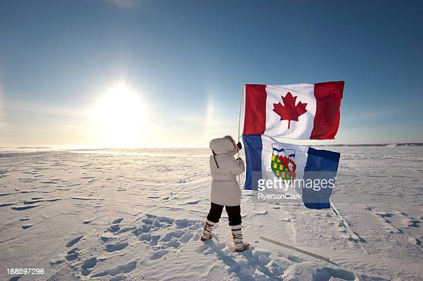 Sundog or Parhelion in Canada's Arctic with Canadian Flag.