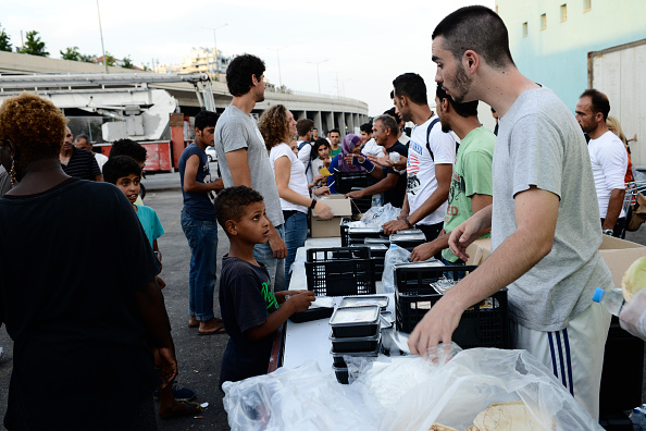 Sundown meals are being distributed in Piraeus refugee camp...