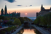 The sun begins to set over Ottawa leaving a silhouette of the Parliament buildings