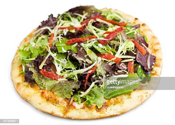 Sundried tomatoes and greens salad pizza