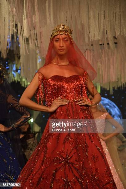 Suneet Varma's celebratory couture collection at the grand finale of the Fashion Design Council of India's 30th edition of India Fashion Week Spring...