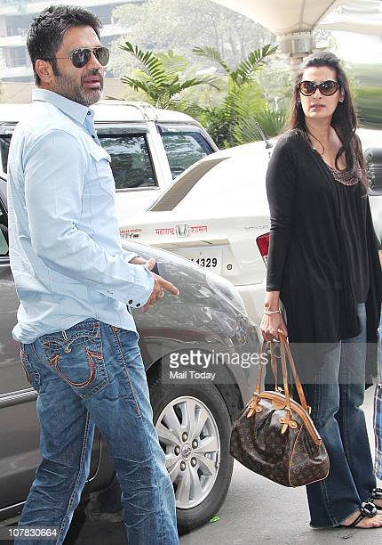 Suneil and Mana Shetty at the Mumbai airport in Mumbai on December 30 2010