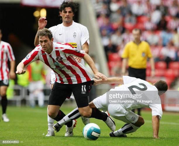 Sunerland's Daryl Murphy battles with Juventus' Alessdandro Birindelli during a Pre Season Friendly at the Stadium of Light Sunderland