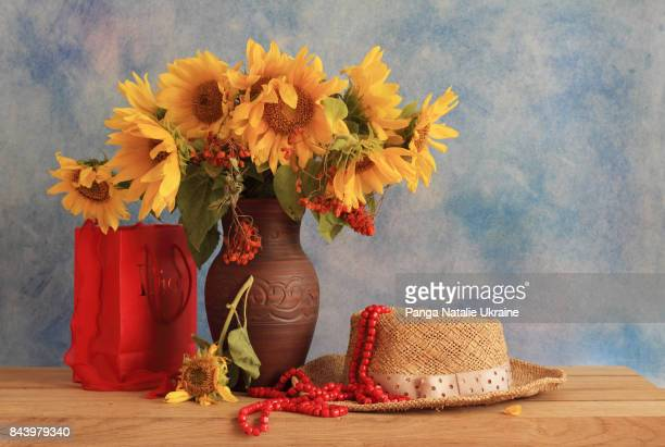 Sunflowers, Red Coral Beads And Hat