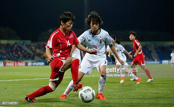 Sung Hyang Sim of Korea DPR is challenged by Saori Takarada of Japan during the FIFA U17 Women's World Cup Finale match between Korea DPR and Japan...