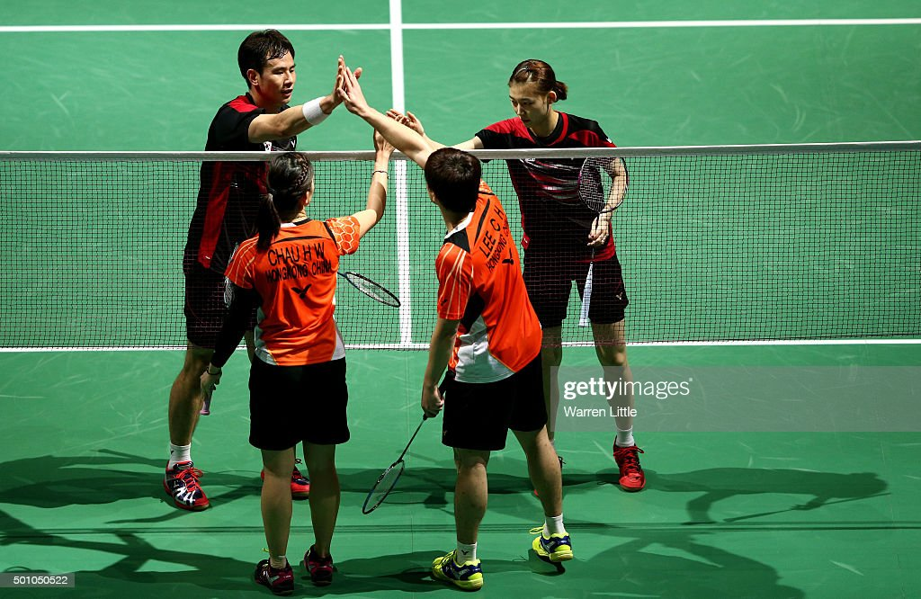 Sung Hyun Ko and Ha Na Kim of Korea shake hands with Chun Hei Reginald Lee and Hoi Wah Chau of Hong Kong after the Mixed Doubles match during day four of the BWF Dubai World Superseries 2015 Finals at the Hamdan Sports Complex on December 12, 2015 in Dubai, United Arab Emirates.