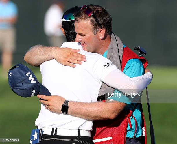Sung Hyun Park of Korea hugs her caddie David Jones on the 18th green after the final round of the US Women's Open on July 16 2017 at Trump National...