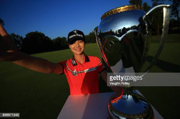 Sung Hyun Park of Korea imitates a ÒselfieÓ as she poses with the trophy after winning the Canadian Pacific Women's Open following the final round at...
