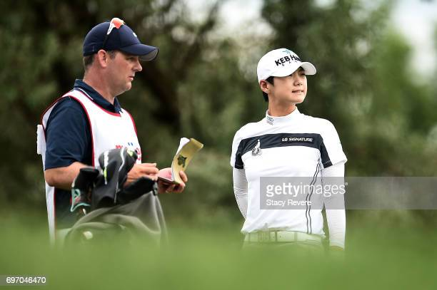 Sung Hyun Park of South Korea speaks with her caddie on the 12th hole during the third round of the Meijer LPGA Classic at Blythefield Country Club...