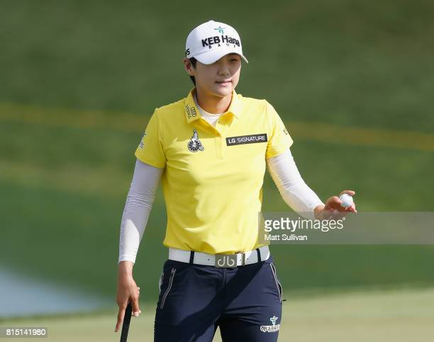 Sung Hyun Park of South Korea waves to the gallery after making a birdie putt on the 18th hole during the third round of the US Women's Open...