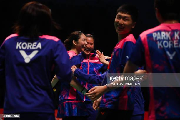 Sung Ji Hyun of South Korea celebrates her victory with teammates following the women's singles Sudirman Cup match against Ratchanok Intanon of...